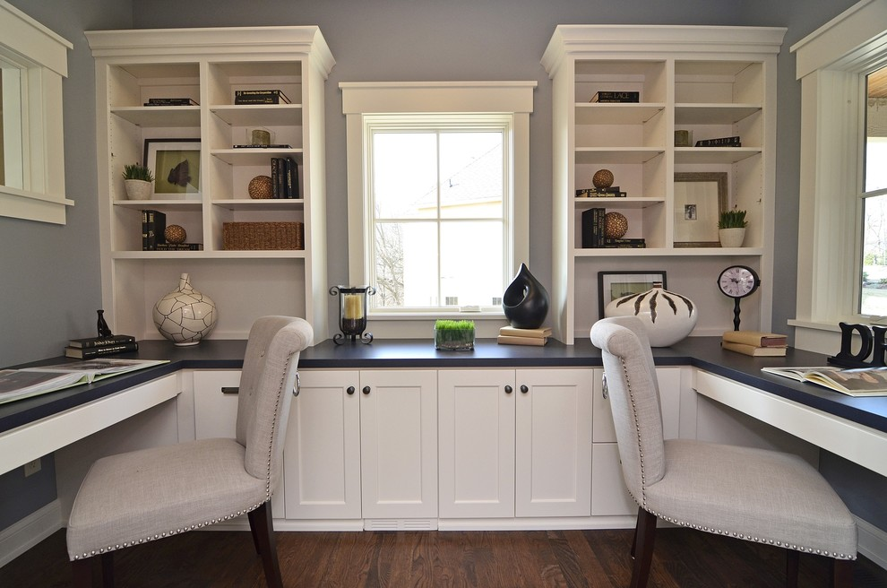 Home office - traditional built-in desk home office idea in Minneapolis with gray walls