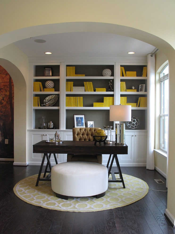 Inspiration for a mid-sized transitional freestanding desk dark wood floor home office remodel in DC Metro with gray walls