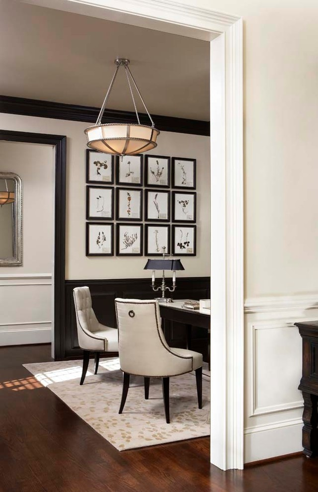 Study room - large traditional freestanding desk dark wood floor study room idea in Other with white walls