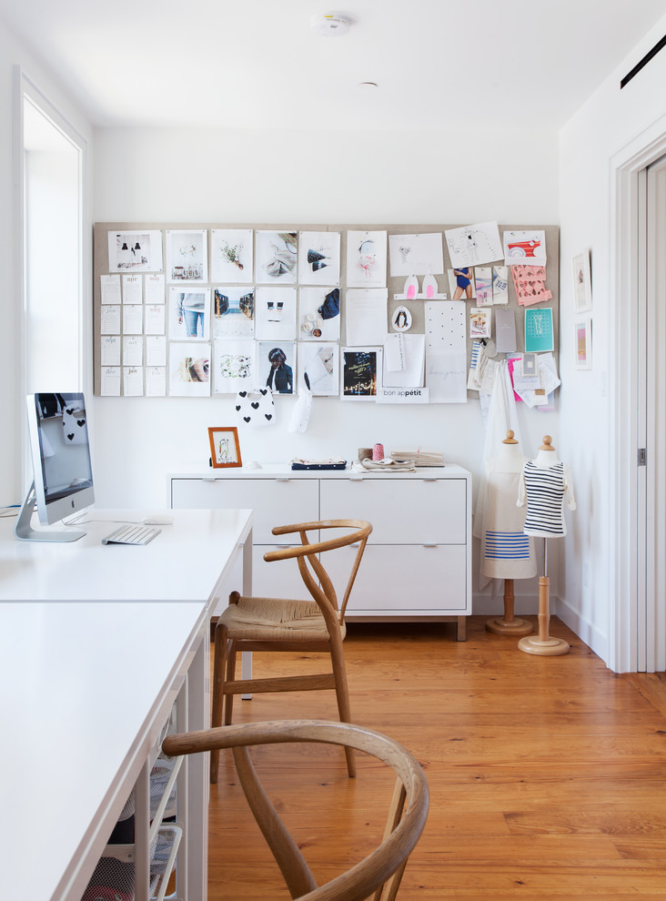 Inspiration for a mid-sized contemporary freestanding desk medium tone wood floor and brown floor home studio remodel in New York with white walls and no fireplace