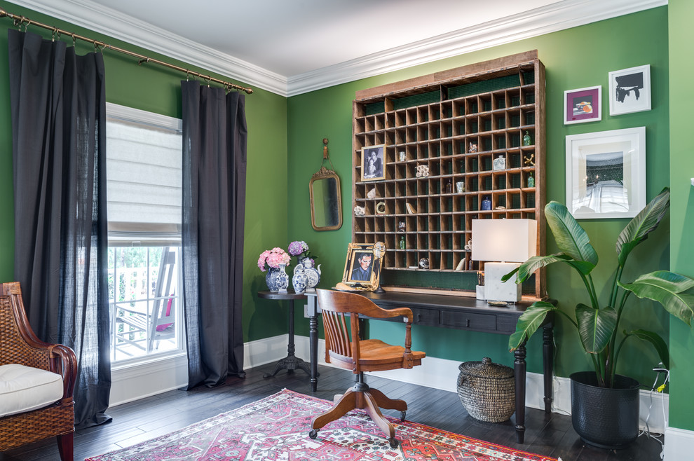 Large island style freestanding desk dark wood floor and black floor study room photo in Atlanta with green walls and no fireplace