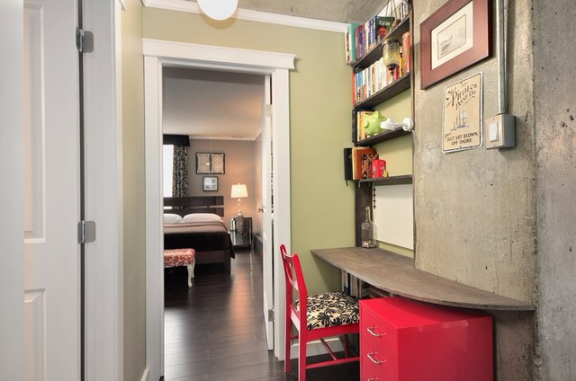 Small trendy built-in desk dark wood floor home office photo in Vancouver with green walls