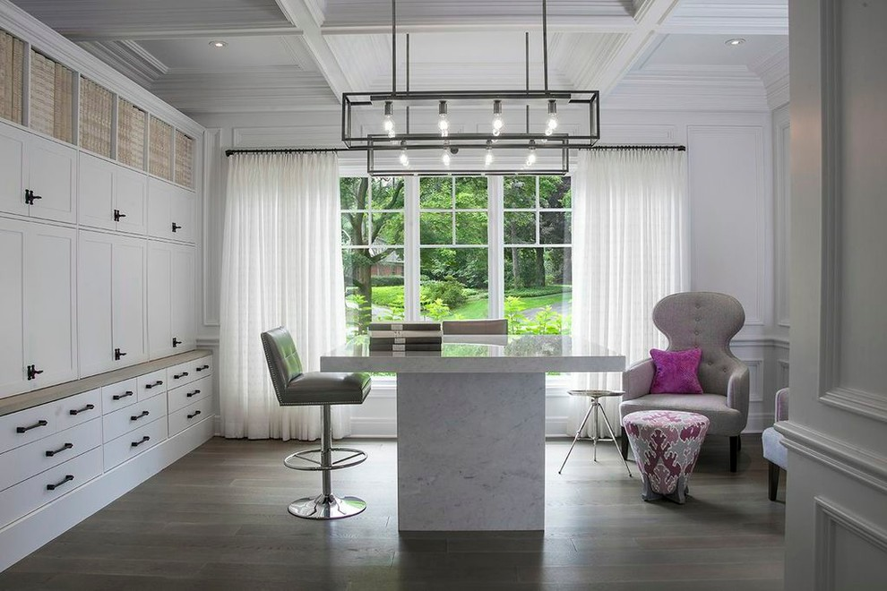 Home office - contemporary freestanding desk dark wood floor home office idea in Detroit with white walls