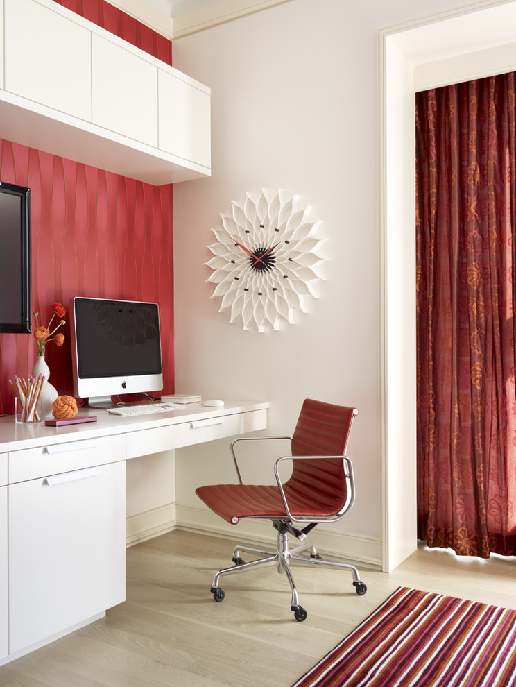 Home office - contemporary built-in desk light wood floor home office idea in Other with red walls