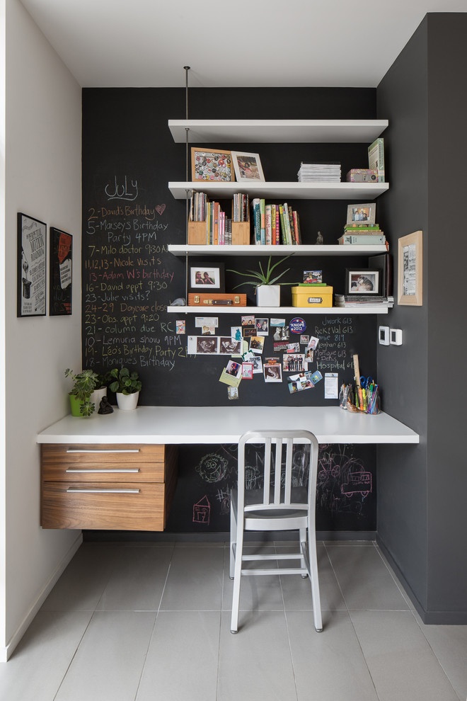 Example of a trendy built-in desk gray floor study room design in Ottawa with black walls and no fireplace