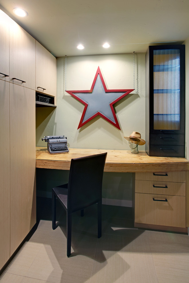 Inspiration for a contemporary built-in desk beige floor home office remodel in Other