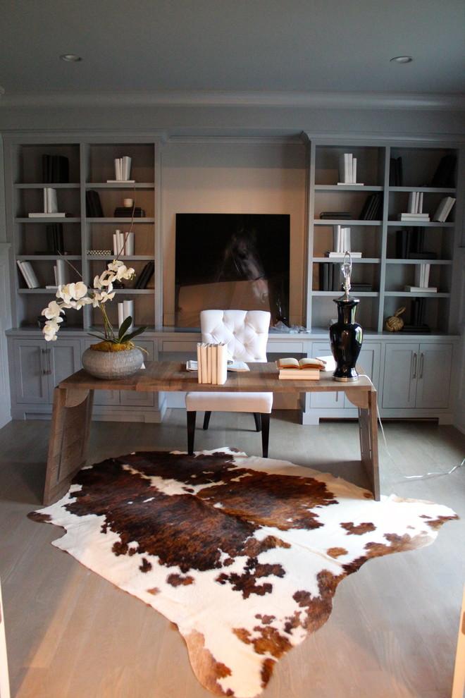 Trendy freestanding desk dark wood floor home office photo in New York