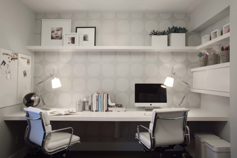 Example of a trendy built-in desk home office design in Vancouver with gray walls