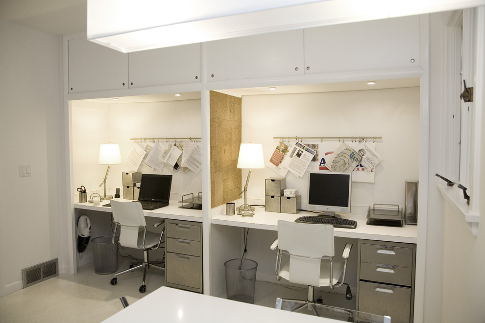 Example of a trendy built-in desk carpeted home office design in New York with white walls