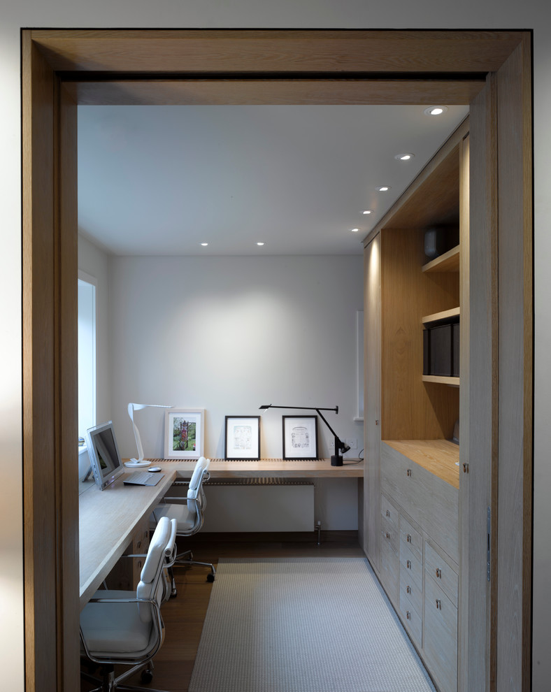 Design ideas for a contemporary home office in London with white walls and dark hardwood flooring.