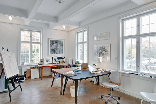 Inspiration for a mid-sized contemporary freestanding desk medium tone wood floor home studio remodel in Copenhagen with white walls