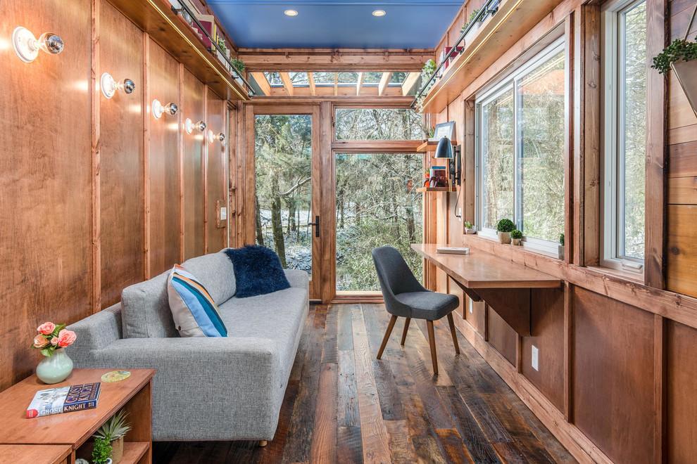 Urban dark wood floor and brown floor home office photo in Nashville with brown walls