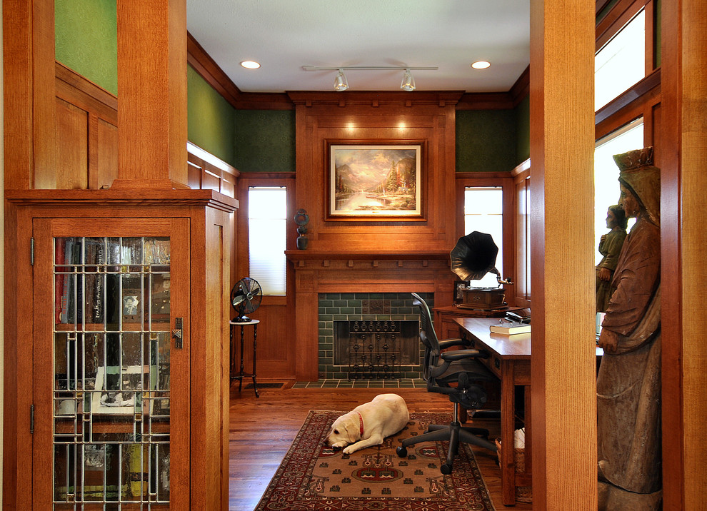 Arts and crafts home office photo in Dallas with green walls, a tile fireplace and a standard fireplace
