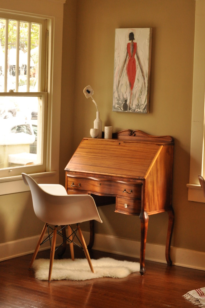 Inspiration for a timeless freestanding desk dark wood floor home office remodel in San Diego with brown walls