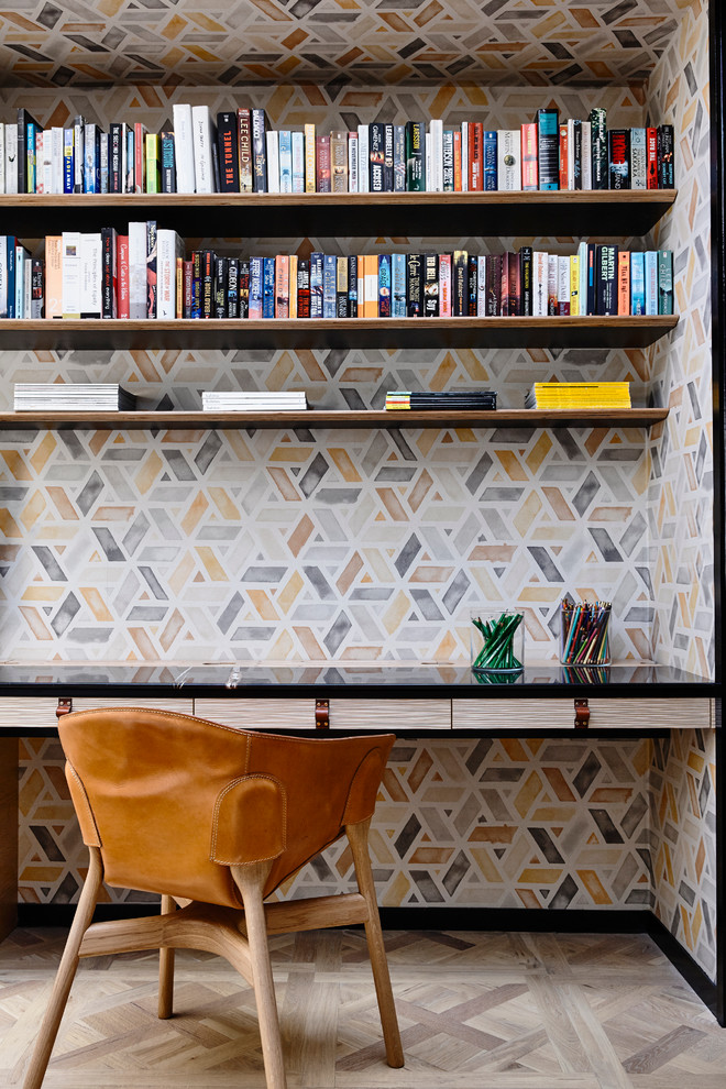 Example of a small trendy built-in desk study room design in Melbourne with multicolored walls