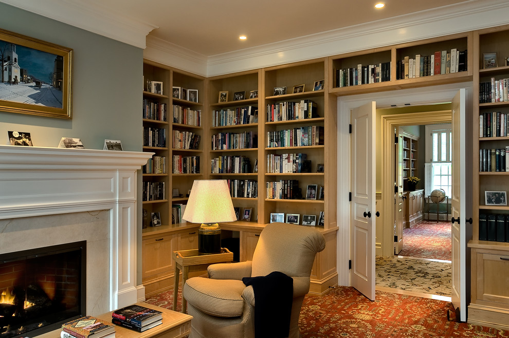 Example of a classic carpeted home office design in New York with gray walls
