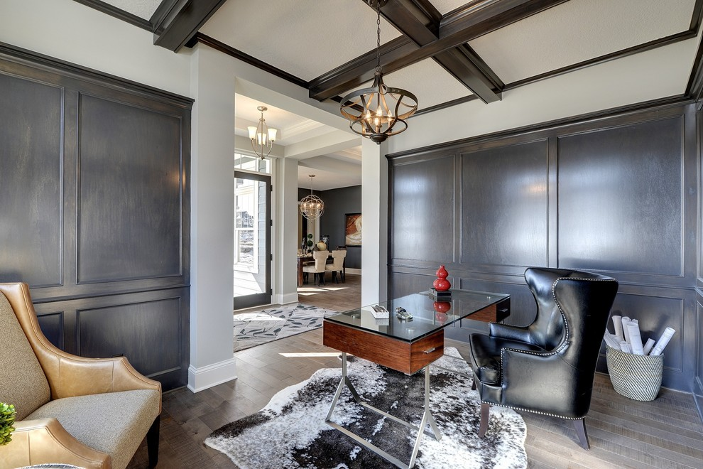 Inspiration for a mid-sized timeless freestanding desk home office remodel in Minneapolis with no fireplace and white walls