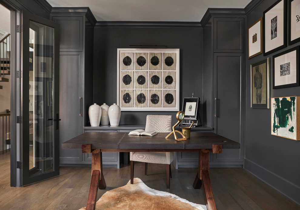 Study room - mid-sized transitional freestanding desk dark wood floor and brown floor study room idea in Chicago with black walls and no fireplace