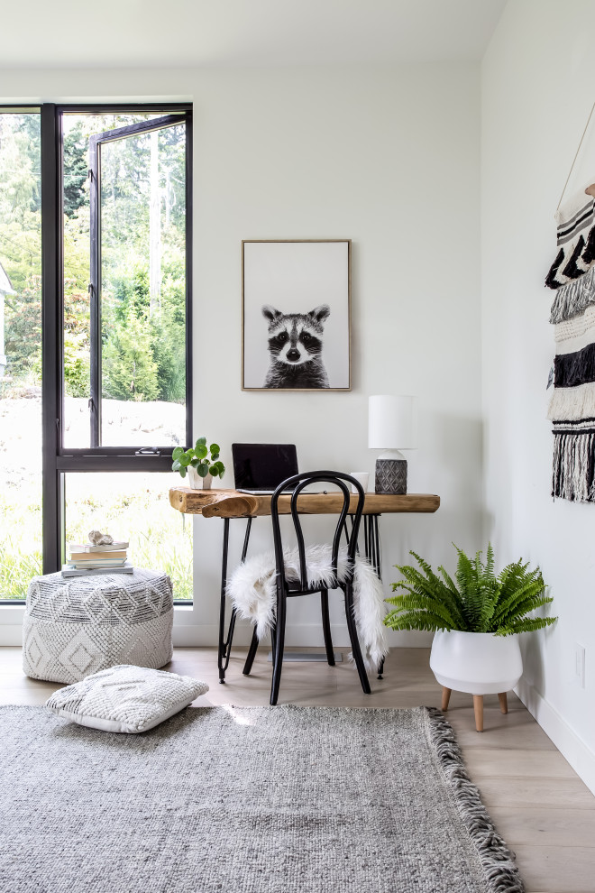 Small danish freestanding desk light wood floor study room photo in Vancouver with white walls