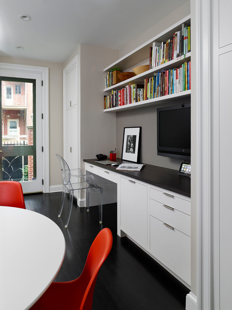 Inspiration for a transitional built-in desk black floor study room remodel in Philadelphia with gray walls