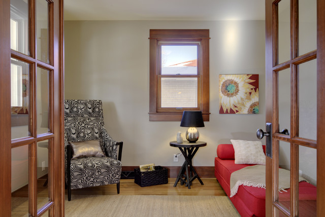 Example of an eclectic light wood floor and brown floor home office design in Denver with beige walls and no fireplace