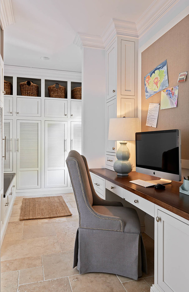 Inspiration for a timeless beige floor home office remodel in Charlotte with white walls