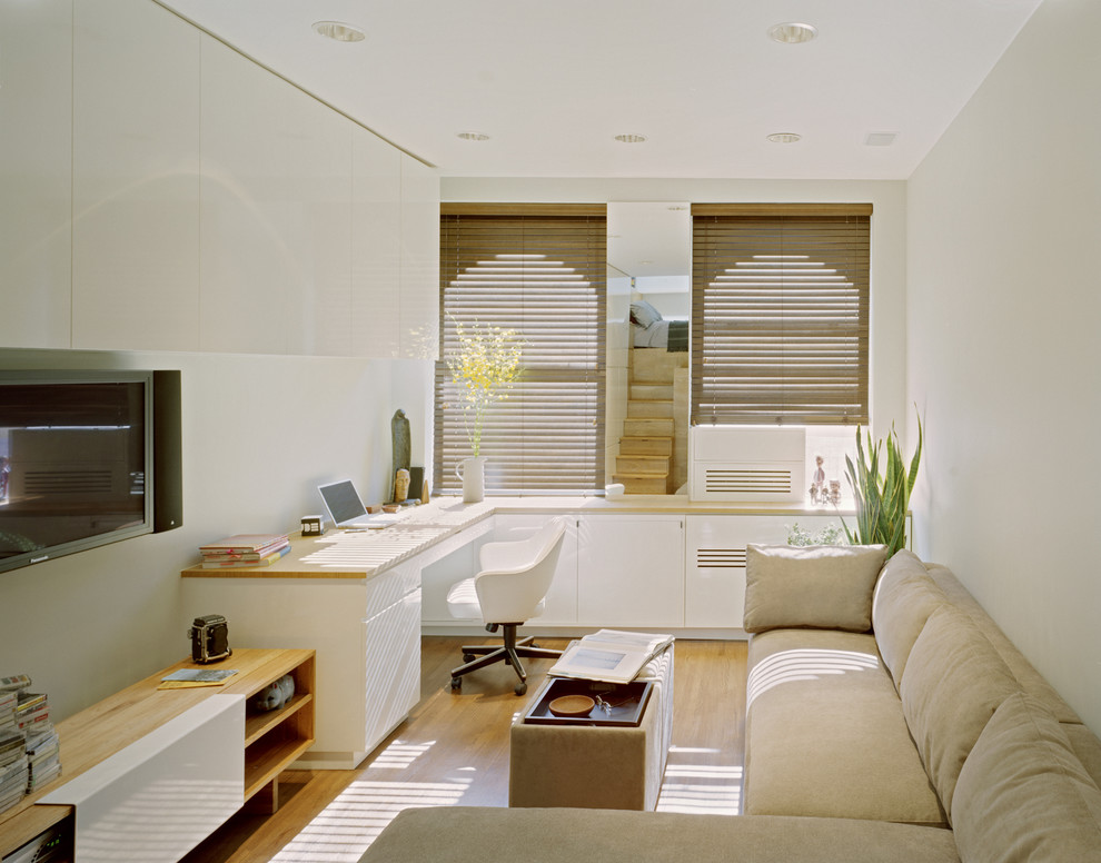 This is an example of a contemporary study in New York with white walls.