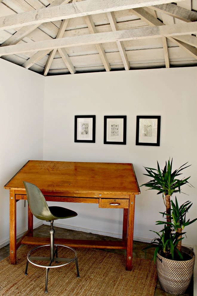 Example of a classic freestanding desk home office design in Los Angeles with white walls