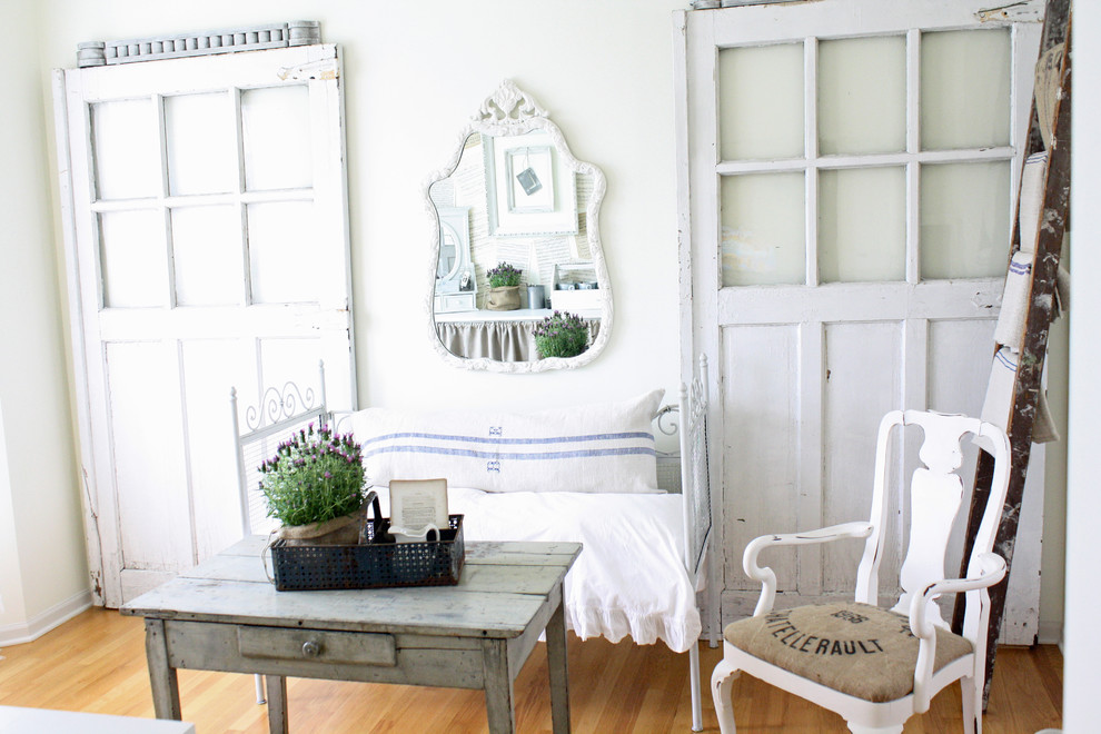 Home office - shabby-chic style medium tone wood floor home office idea in Chicago with white walls
