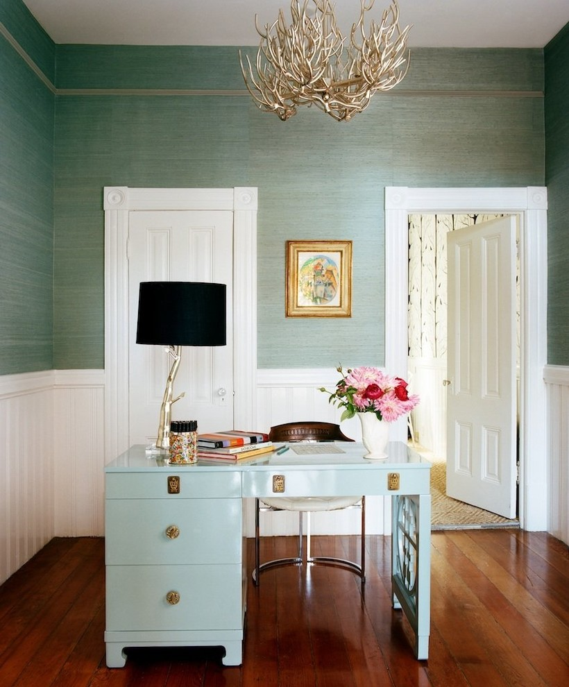 Example of an eclectic freestanding desk dark wood floor home office design in Other with green walls
