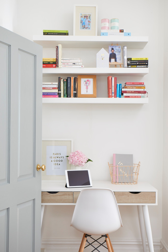 Mid-sized danish freestanding desk home office photo in London with white walls