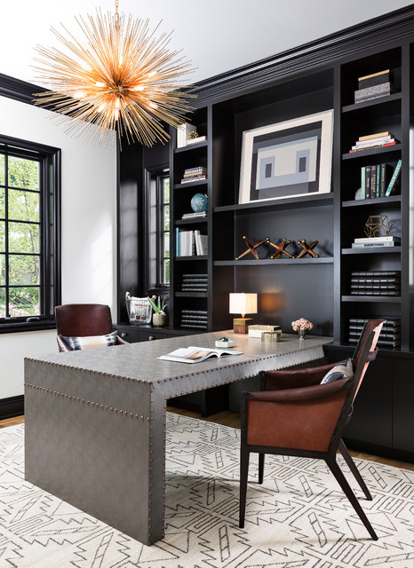 Inspiration for a large transitional built-in desk medium tone wood floor and brown floor home office library remodel in Detroit with black walls
