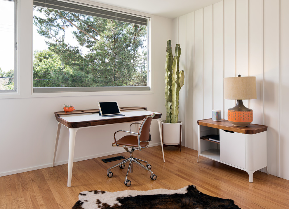 Small 1960s freestanding desk medium tone wood floor and brown floor study room photo in San Francisco with white walls and no fireplace