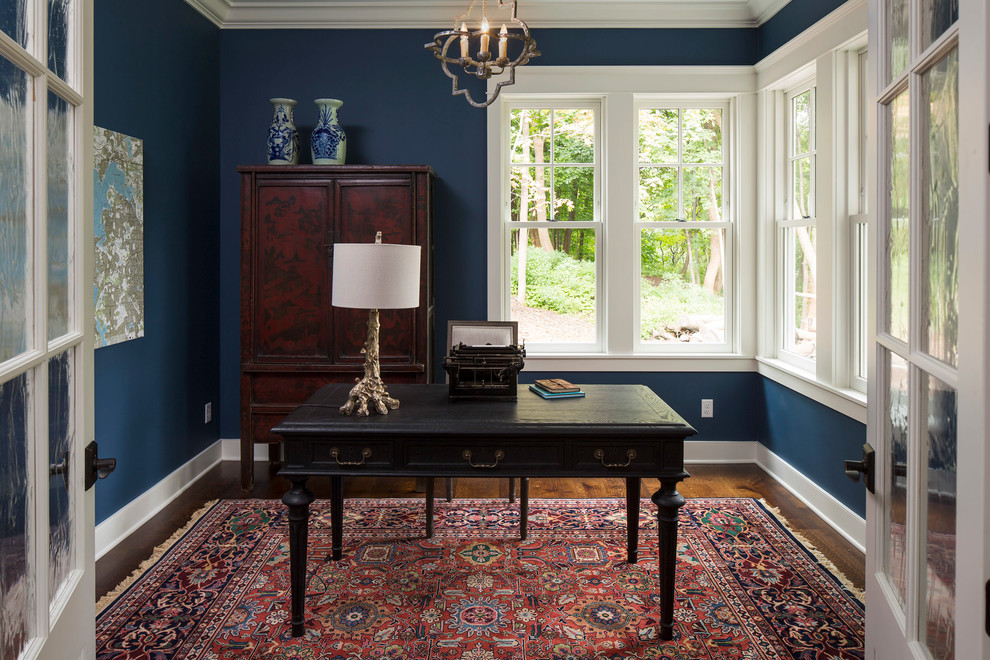 Example of a classic freestanding desk study room design in Minneapolis with blue walls