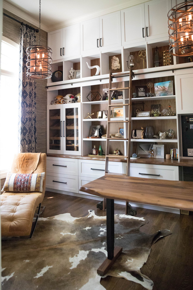 Example of a transitional freestanding desk dark wood floor and brown floor home office design in Kansas City with gray walls