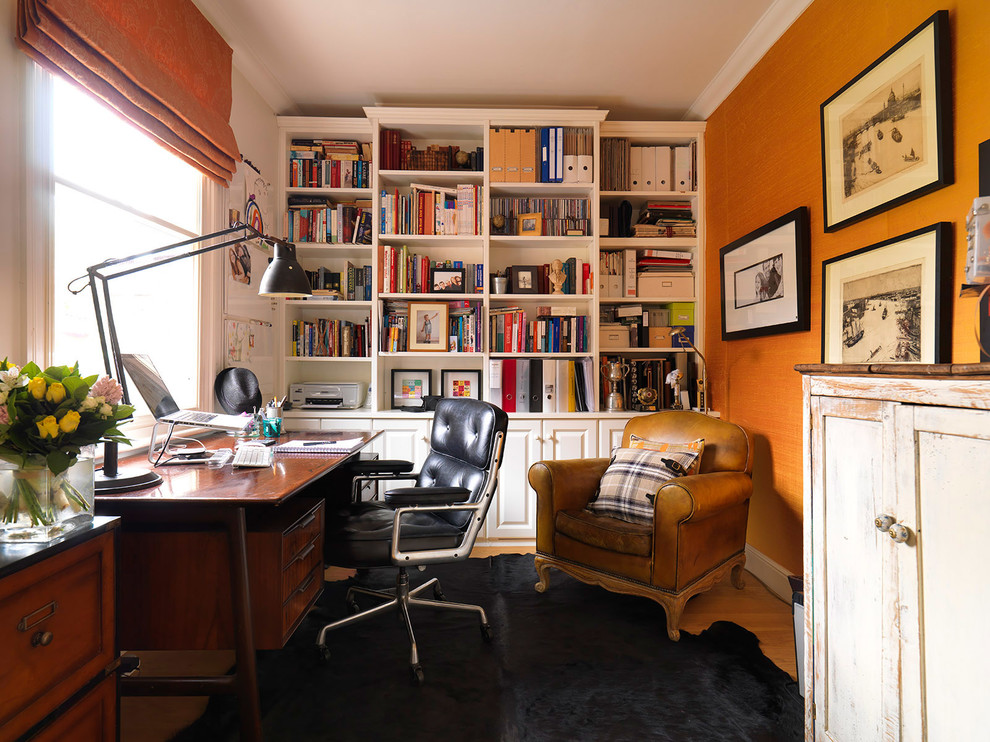 Inspiration for a small timeless freestanding desk medium tone wood floor study room remodel in London with orange walls and no fireplace