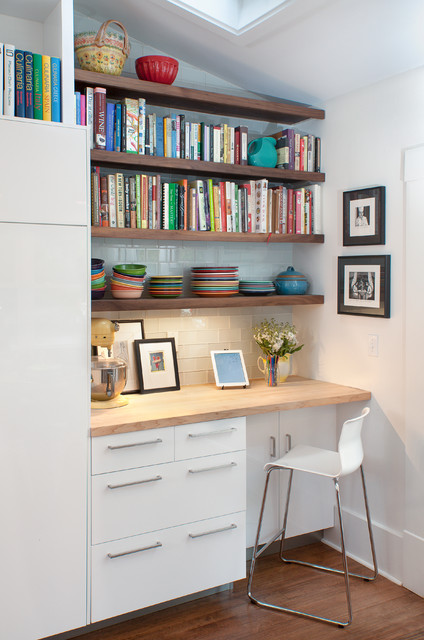 Trendy built-in desk dark wood floor home office photo in Other with white walls