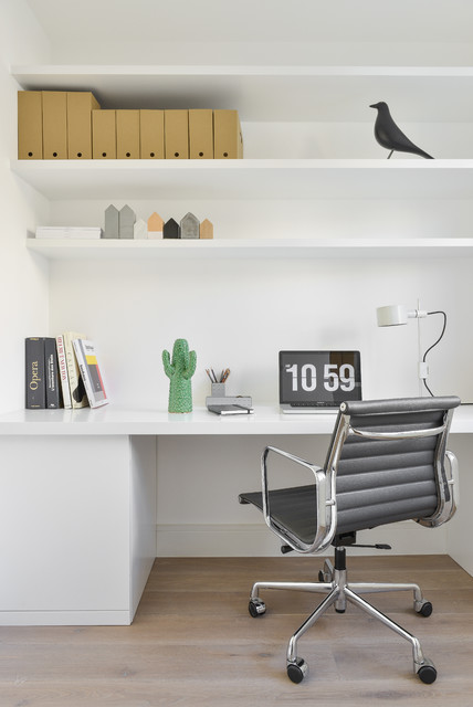 Scandi study in London with white walls and a built-in desk.