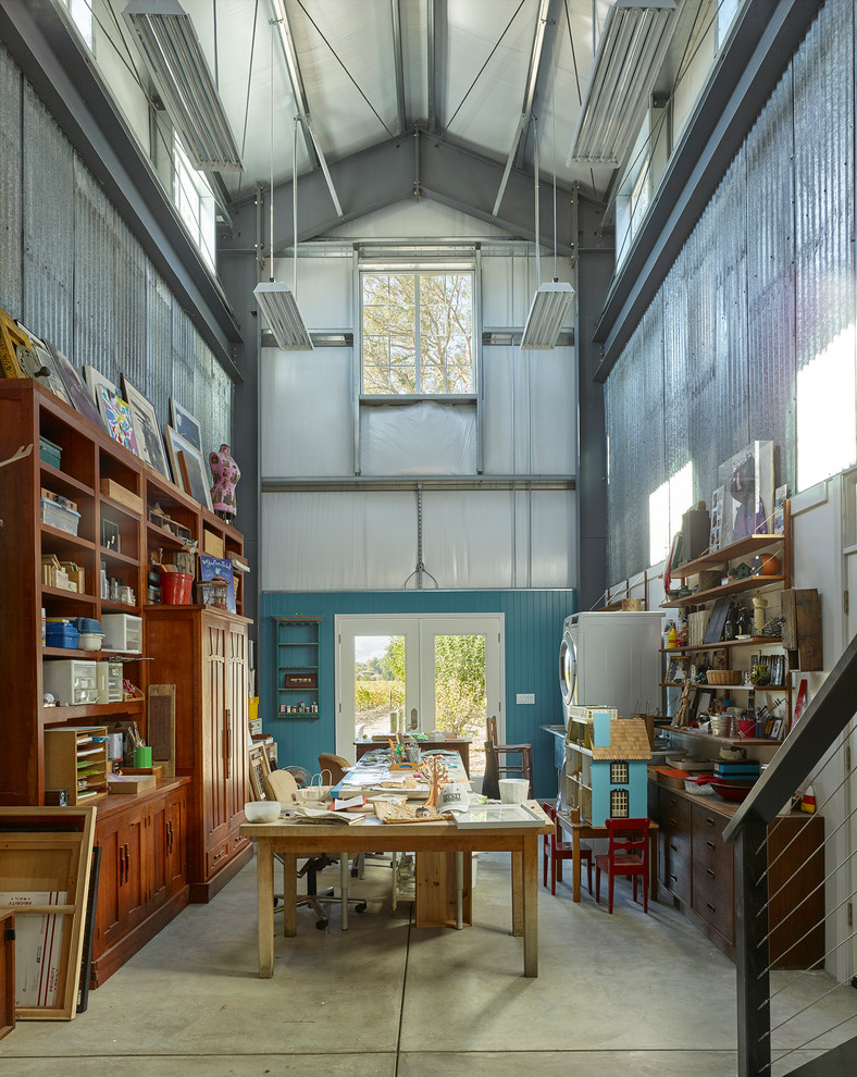 Inspiration for a cottage freestanding desk concrete floor and gray floor home studio remodel in San Francisco with blue walls