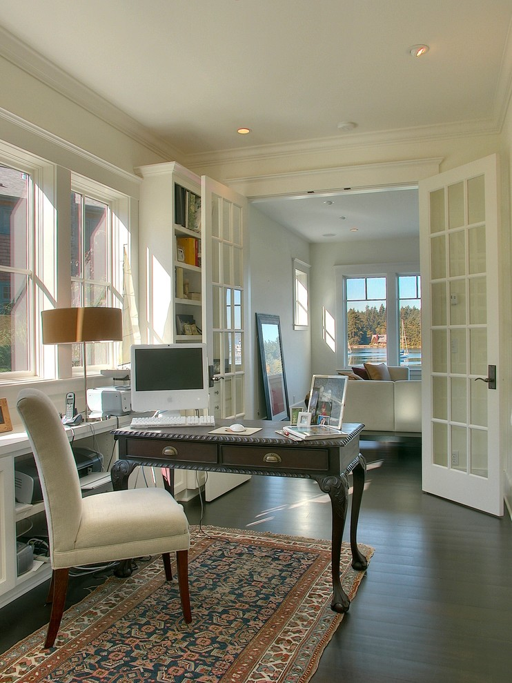 Inspiration for a victorian freestanding desk dark wood floor home office remodel in Seattle with white walls