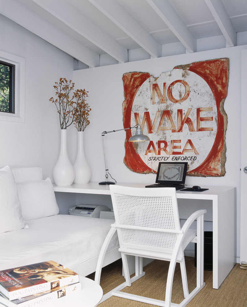 Trendy freestanding desk carpeted home office photo in New York with white walls