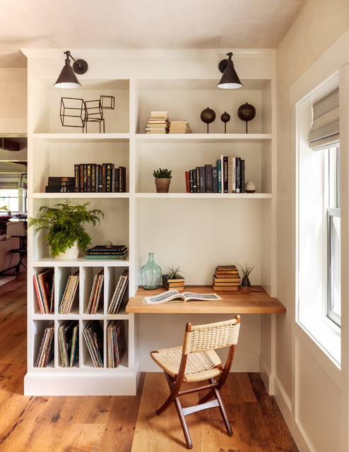 Inspiration for a country built-in desk medium tone wood floor and brown floor home office remodel in Boston with beige walls