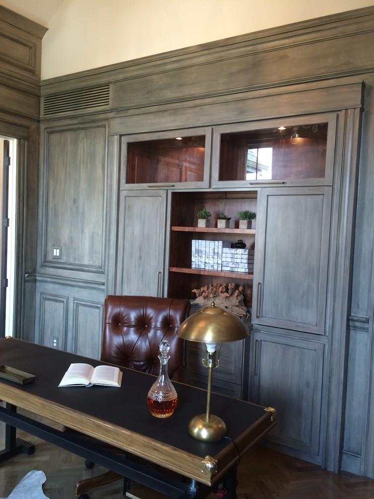 Study room - large traditional freestanding desk dark wood floor study room idea in Cincinnati with gray walls and no fireplace