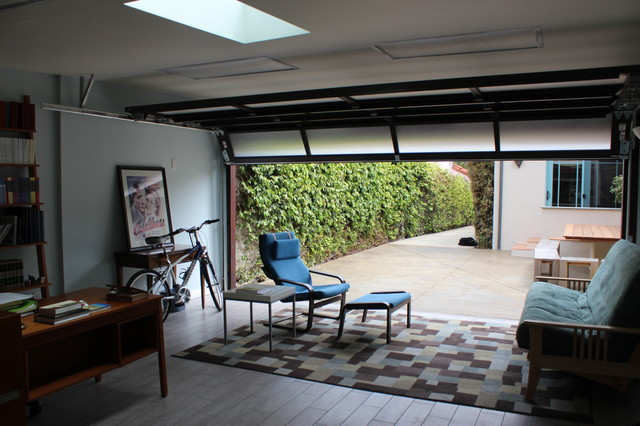 Garage conversion contemporary home office and library