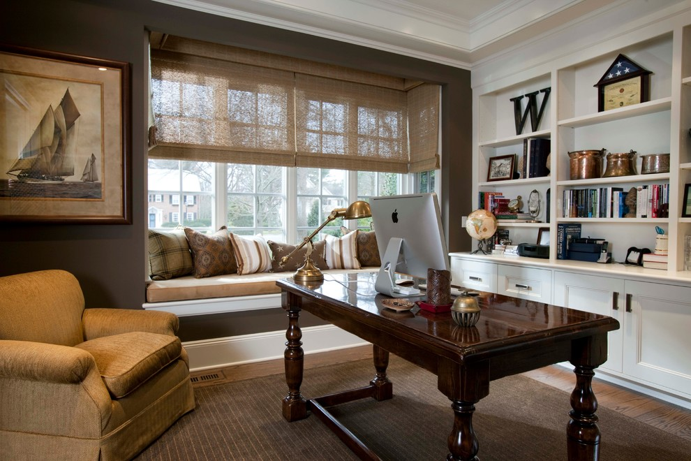 Inspiration for a timeless freestanding desk dark wood floor and brown floor home office remodel in New York with brown walls