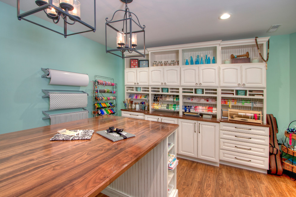 Craft room - large traditional medium tone wood floor craft room idea in St Louis with blue walls