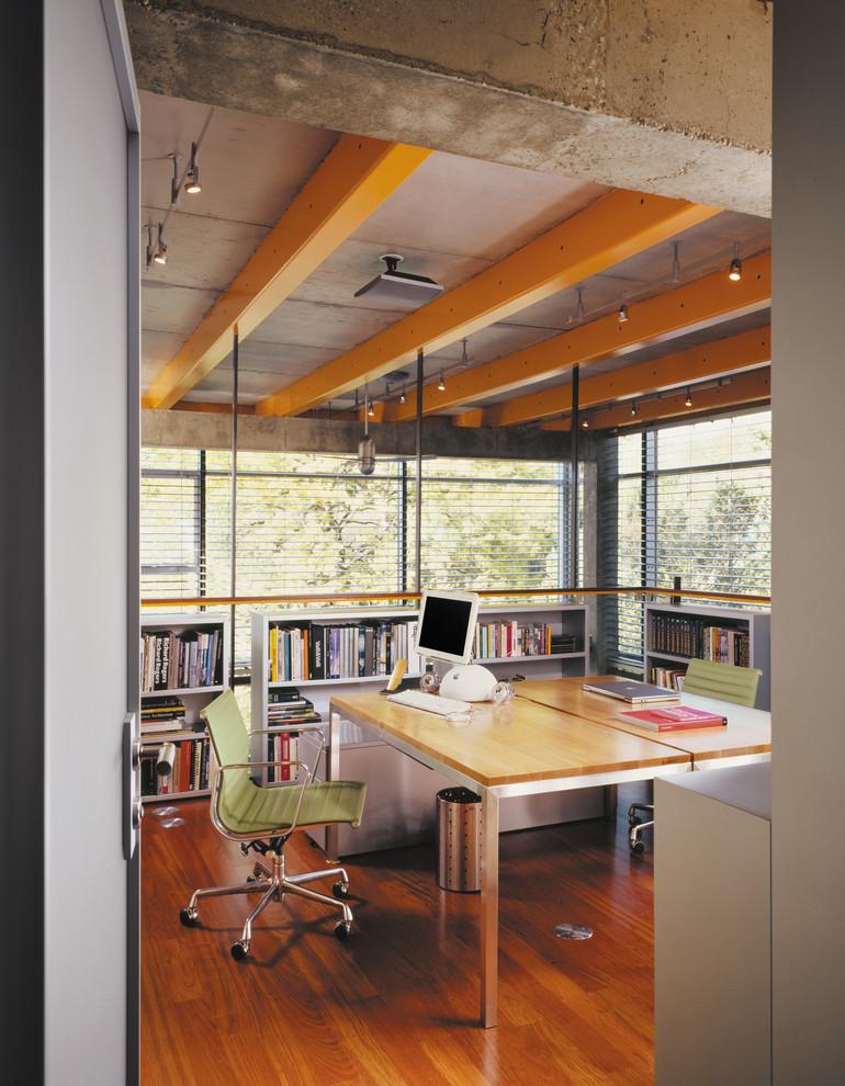 Home office - industrial freestanding desk medium tone wood floor home office idea in Chicago