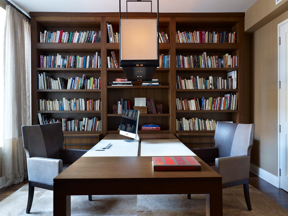 Home office - contemporary built-in desk dark wood floor home office idea in Chicago with brown walls