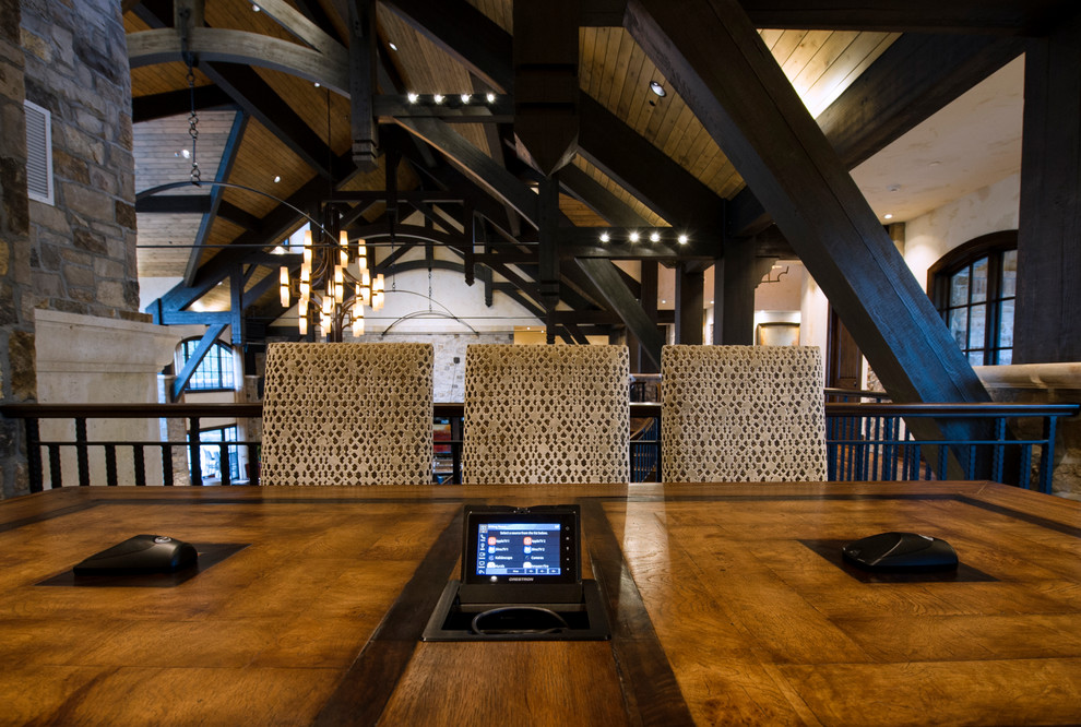 Large mountain style freestanding desk medium tone wood floor study room photo in Denver
