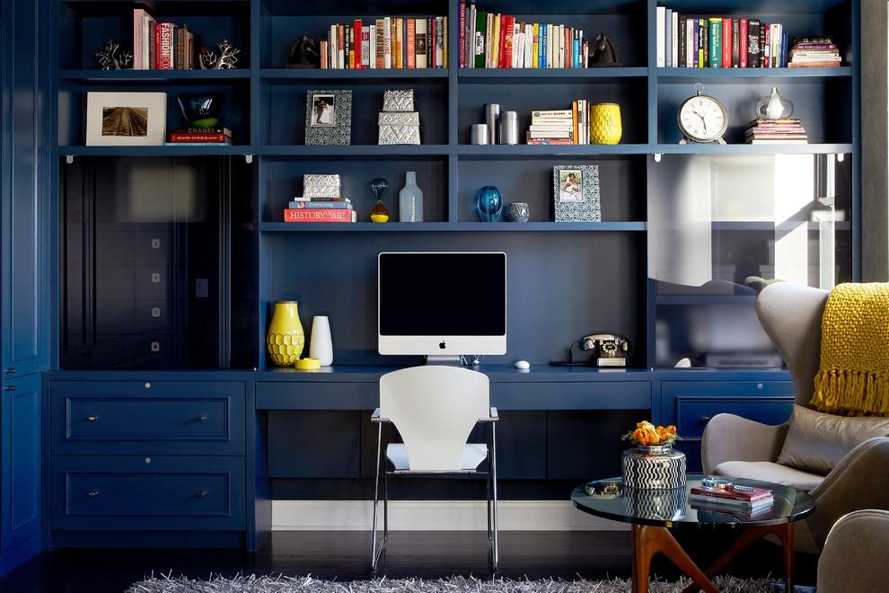 Study room - contemporary built-in desk dark wood floor study room idea in New York with blue walls